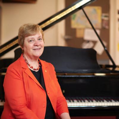 Elizabeth Koch next to piano